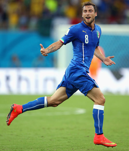 Claudio Marchisio of Italy celebrates scoring his team's first goal against England