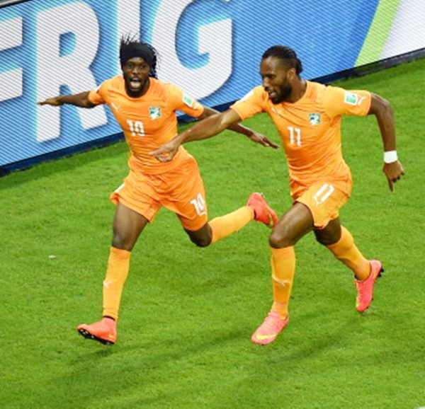 Gervinho of the Ivory Coast (left) celebrates scoring his team's second goal with teammate Didier Drogba