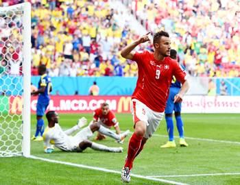 Haris Seferovic celebrates his goal against Ecuador
