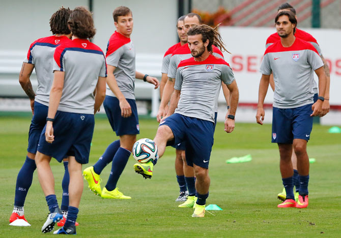 Kyle Beckerman of the United States runs drills during their training session
