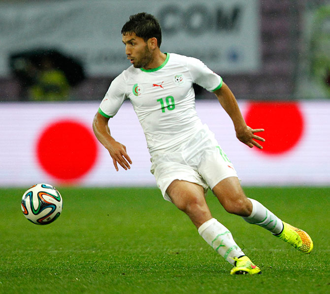 Algeria's Abdelmoumene Djabou controls the ball