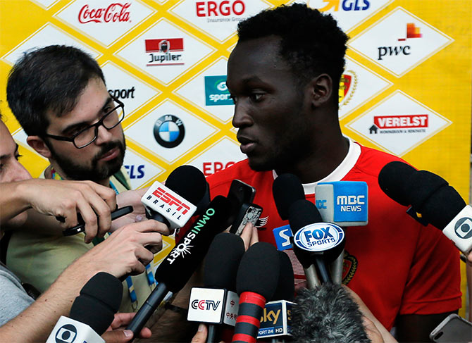 Belgium's national team player Romelu Lukaku talks to reporters before a training session