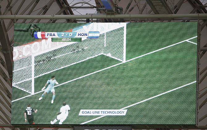 A video replay of France's Karim Benzema's goal using goal-line technology is pictured on a screen during their 2014 World Cup Group E soccer match against Honduras at the Beira Rio stadium in Porto Alegre during the 2018 FIFA World Cup