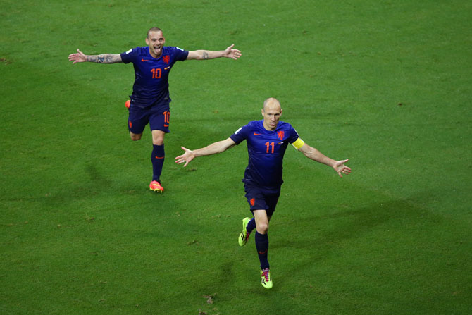 Arjen Robben of the Netherlands (right) celebrates with Wesley Sneijder after scoring the team's fifth goal