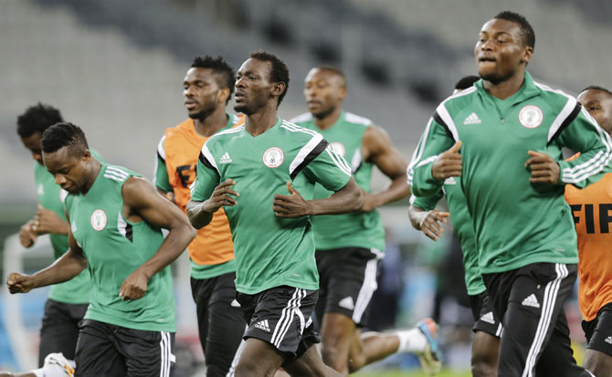 Nigeria's national soccer team players run during a training session at the Arena Baixada soccer stadium in Curitiba on Sunday