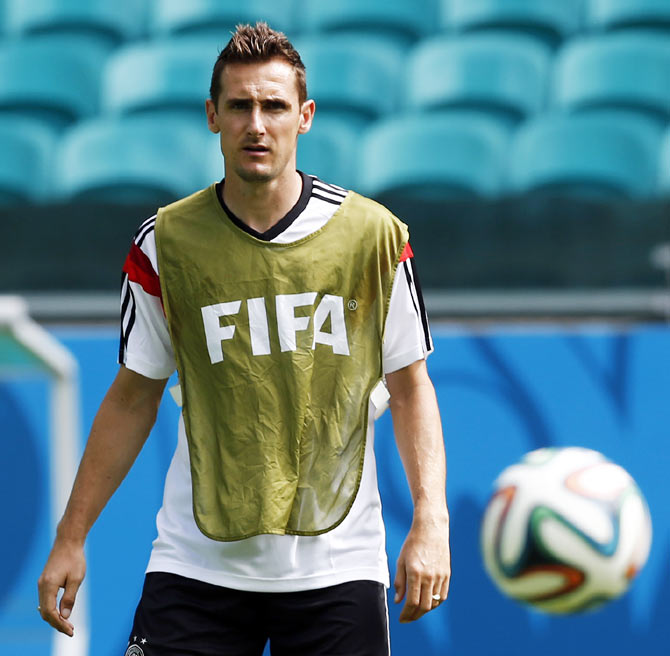 Germany's Miroslav Klose watches the ball during a training session at the Arena Fonte Nova stadium on Sunday