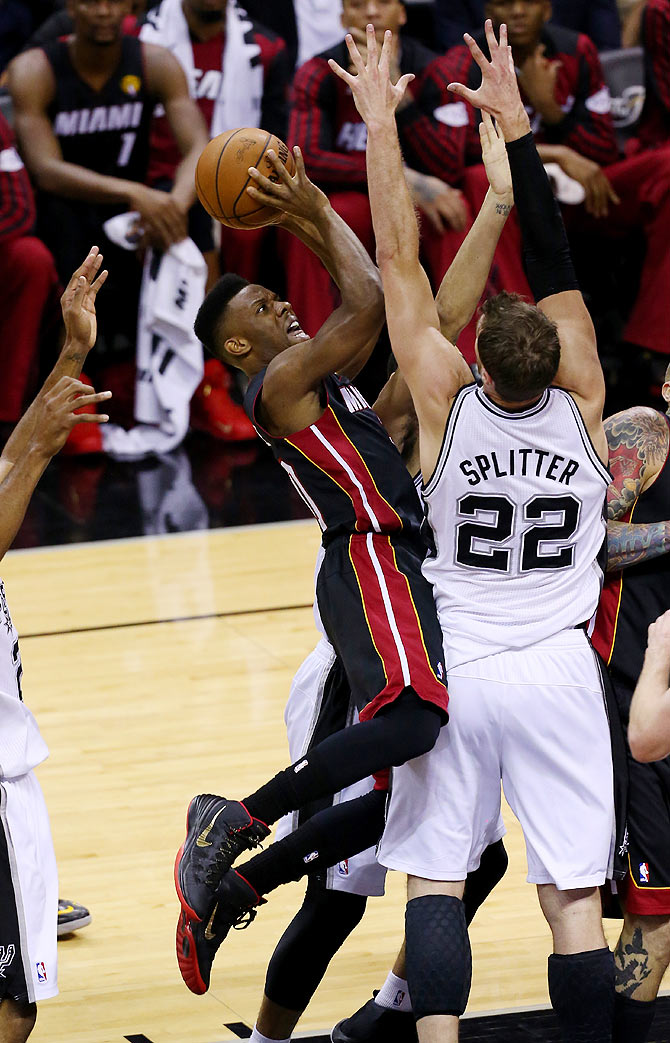 Norris Cole of the Miami Heat goes to the basket against Tiago Splitter of the San Antonio Spurs on Sunday