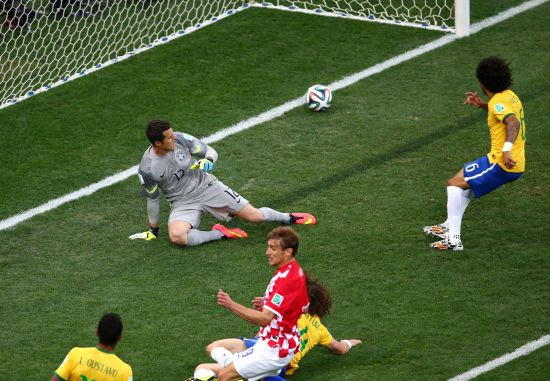 Julio Cesar (left) watches helplessly as Marcelo deflectes the ball into Brazil's goal