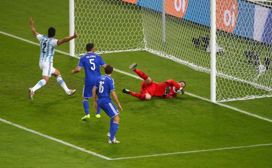 Sead Kolasinac of Bosnia and Herzegovina (extreme right) scores an own goal past goalkeeper Asmir Begovic