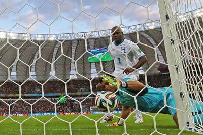 Goalkeeper Noel Valladares of Honduras tries to prevent the ball from crossing the goalline following a shot by France's Karim Benzema.Ka