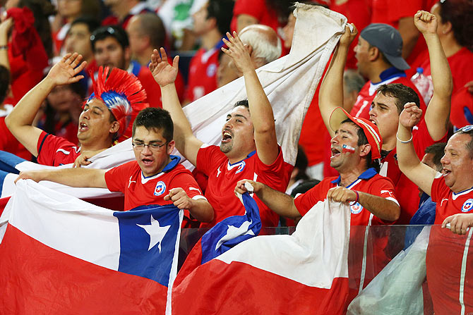 Chile fans cheer during the 2014 FIFA World Cup Brazil Group B match between Chile and Australia at Arena Pantanal in Cuiaba on Friday