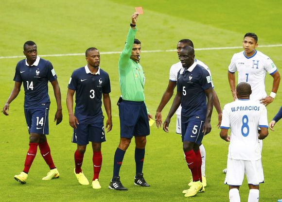 Wilson Palacios of Honduras (No 8) receives a red card from referee Sandro Ricci of Brazil