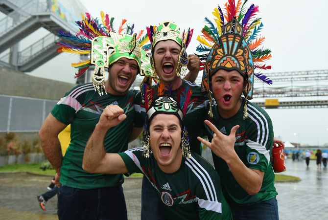 A group of Mexico fans cheer