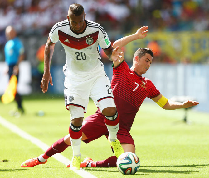 Jerome Boateng of Germany challenges Cristiano Ronaldo of Portugal on Monday