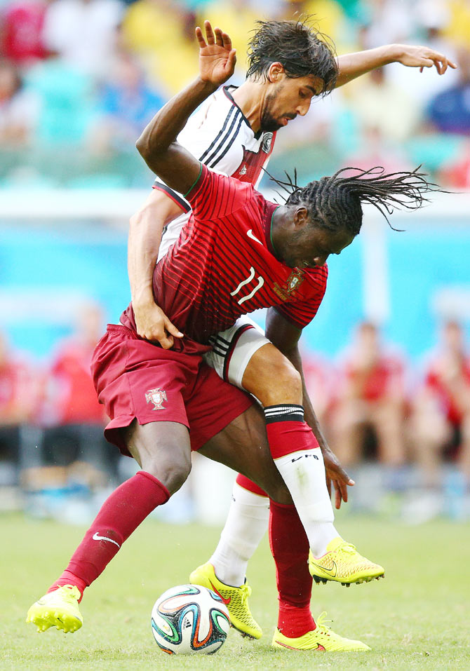 Eder (left) of Portugal battles for the ball with Sami Khedira of Germany on Monday