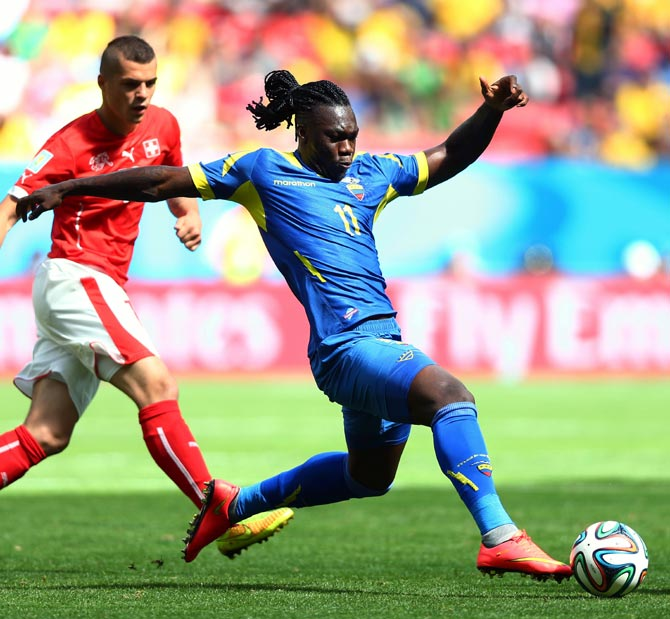 Ecuador's Felipe Caicedo (right) dribbles past Granit Xhaka of Switzerland