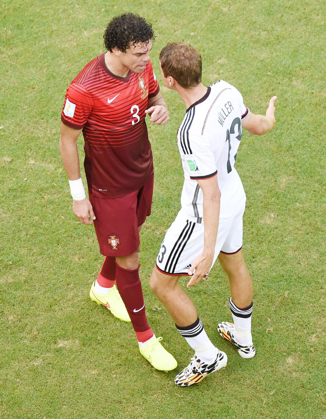 Thomas Mueller of Germany reacts after a headbutt by Pepe of Portugal resulting in the latter receiving a red card on Monday