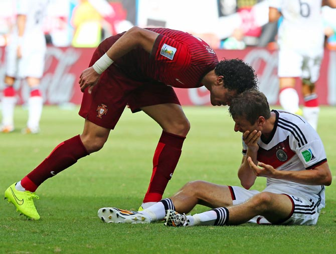Pepe of Portugal headbutts Thomas Mueller of Germany resulting in a red card