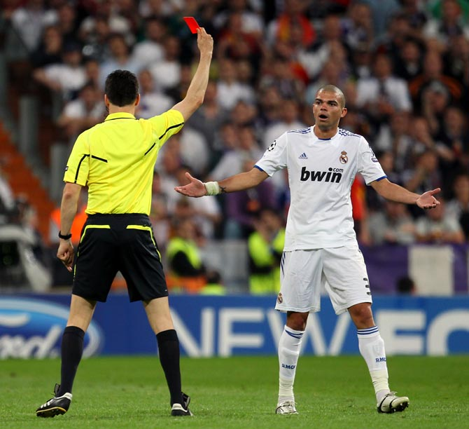 Pepe of Real Madrid is sent off by referee Wolfgang Stark during the UEFA Champions League Semi Final first leg match between Real Madrid and Barcelona in Bernabeu on April 27, 2011.