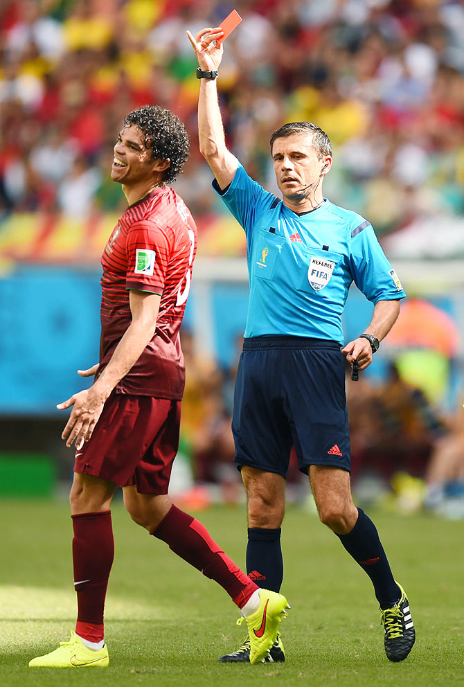 Pepe of Portugal is shown a red card and sent off by referee Milorad Mazic