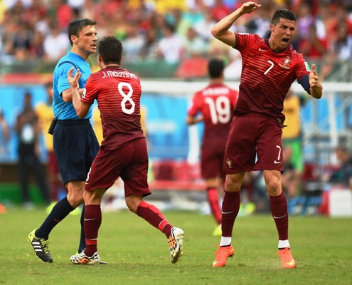 Joao Moutinho (centre) and Cristiano Ronaldo of Portugal (right) appeal to referee Milorad Mazic for a foul