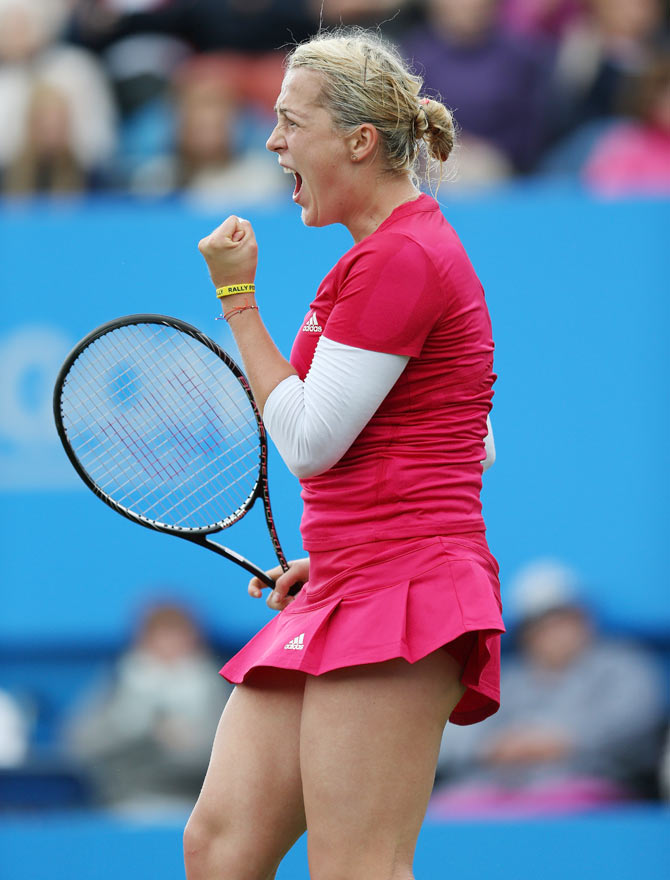 Anastasia Pavlyuchenkova of Russia celebrates a point against Agnieszka Radwanska of Poland during their Women's Singles first round match of the Aegon International at Devonshire Park in Eastbourne, England, on Monday