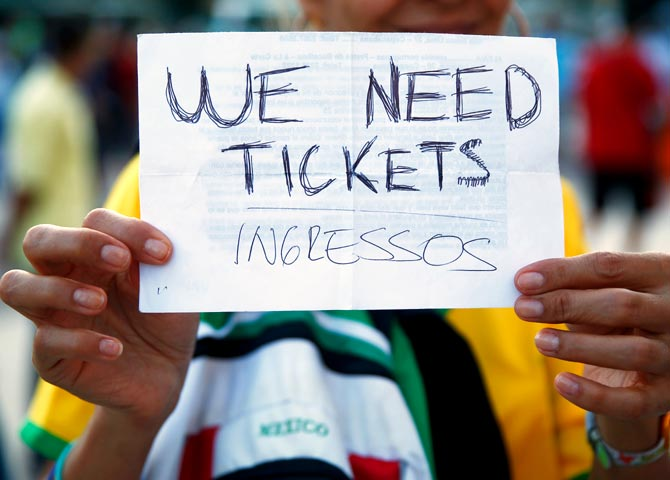 A fan holds a 'We Need Tickets' sign prior to the 2014 FIFA World Cup Brazil Group F match between Argentina and Bosnia-Herzegovina at Maracana in Rio de Janeiro