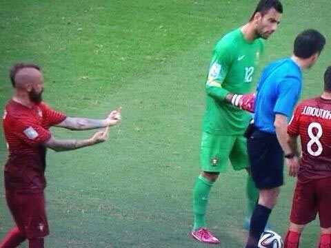 A video grab that went viral on Tuesday shows Portugal's Raul Meireles directing a rude gesture behind the referee's back