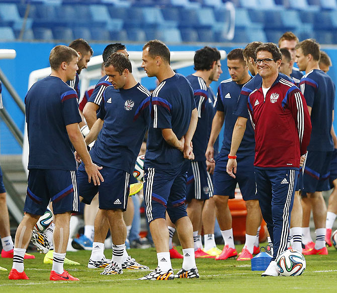 Russia's national soccer team coach Fabio Capello (centre) presides over a training session in the Pantanal arena in Cuiaba on Monday