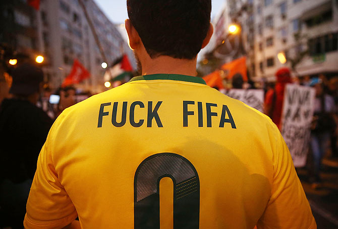 Anti-World Cup protestors gather while attempting to march to Maracana stadium on Sunday