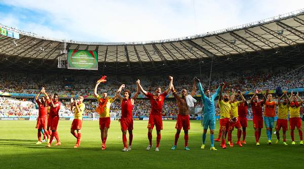 The Belgium players acknowlege their fans after defeating Algeria