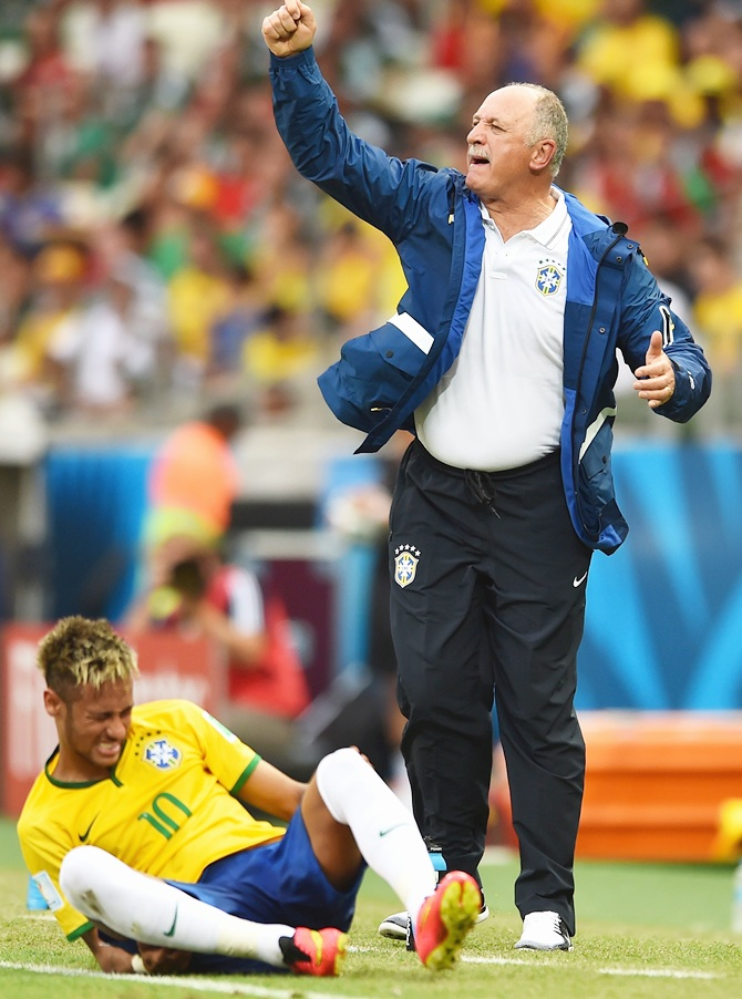 Head coach Luiz Felipe Scolari of Brazil reacts as Neymar sits on the field