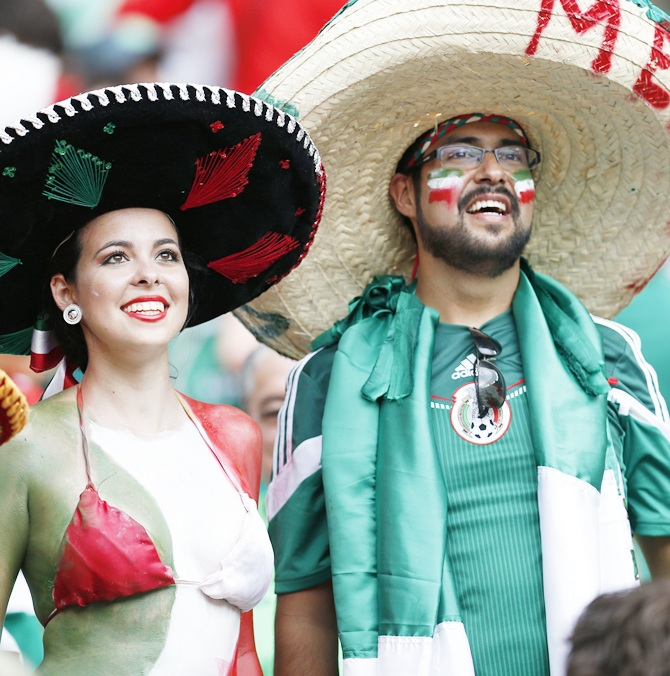 Fans of Mexico wait for the start of their 2014 World Cup Group A soccer match against Brazil at the Castelao arena in Fortaleza