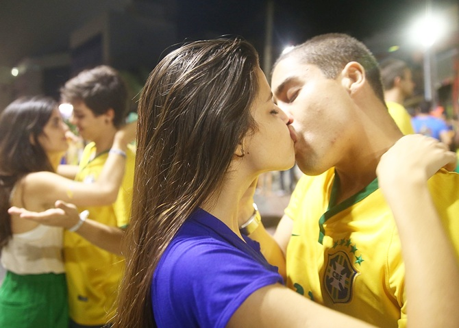 Brazil fans kiss after watching the Brazil-Mexico match