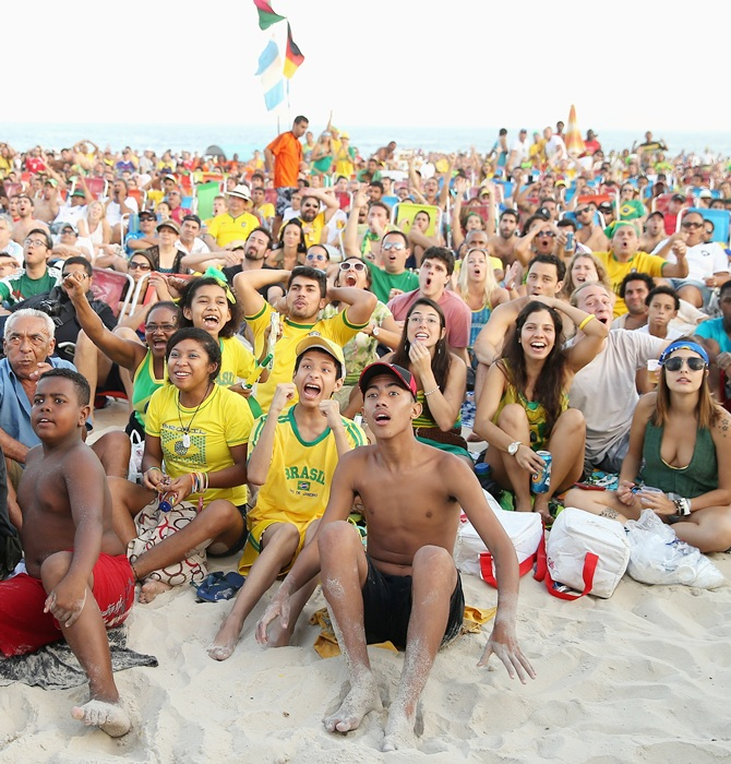 Brazilian Fans gather on Copacabana Beach to watch the Brazil v Mexico match