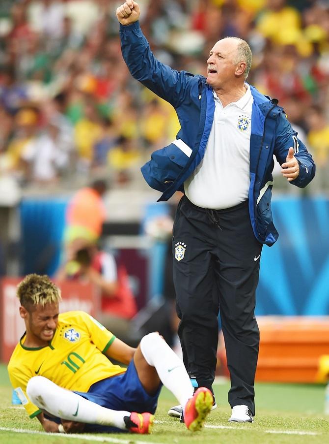 Head coach Luiz Felipe Scolari of Brazil reacts as Neymar sits on the field