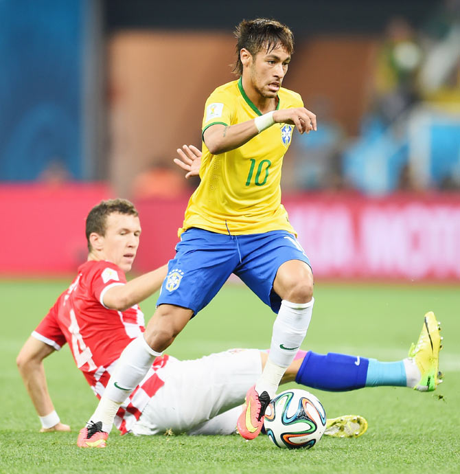 Neymar of Brazil controls the ball as Ivan Perisic of Croatia looks on