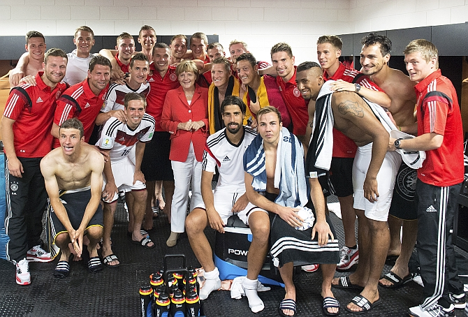 German chancellor Angela Merkel visits the dressing room after the game against Portugal