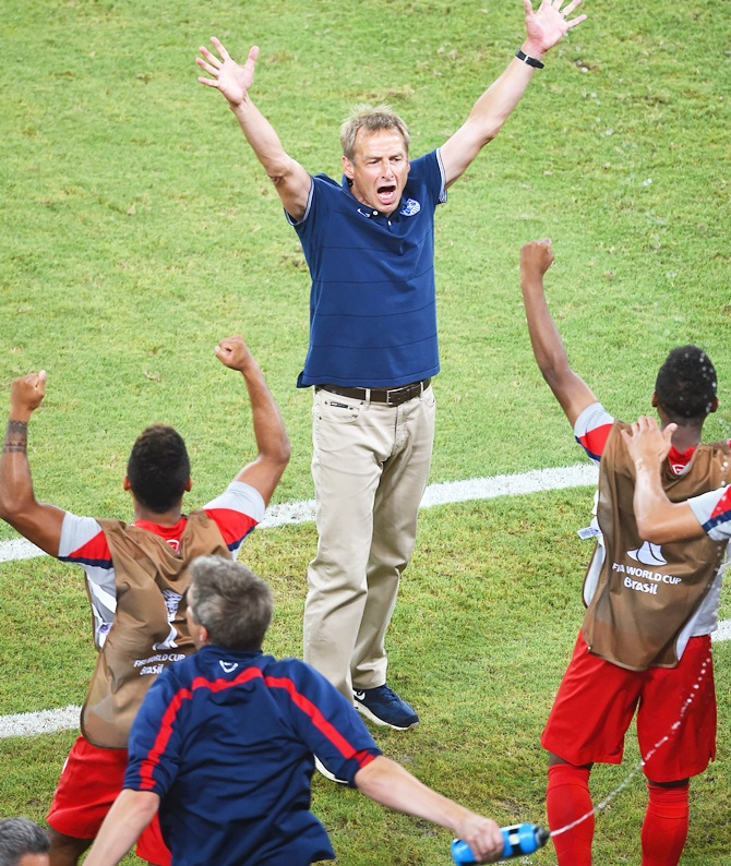 Head coach Jurgen Klinsmann of the United States reacts after defeating Ghana 2-1