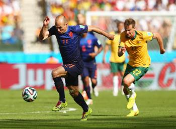 Arjen Robben of the Netherlands controls the ball on his way to scoring his team's first goal against Australia in the Group B match.