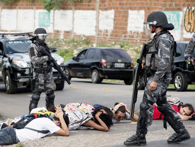 Riot police detain protesters during a demonstration against the 2014 World Cup in Fortaleza