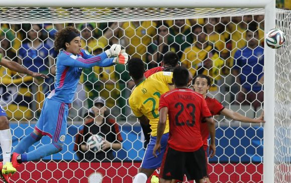 Mexico's goalkeeper Guillermo Ochoa makes a save