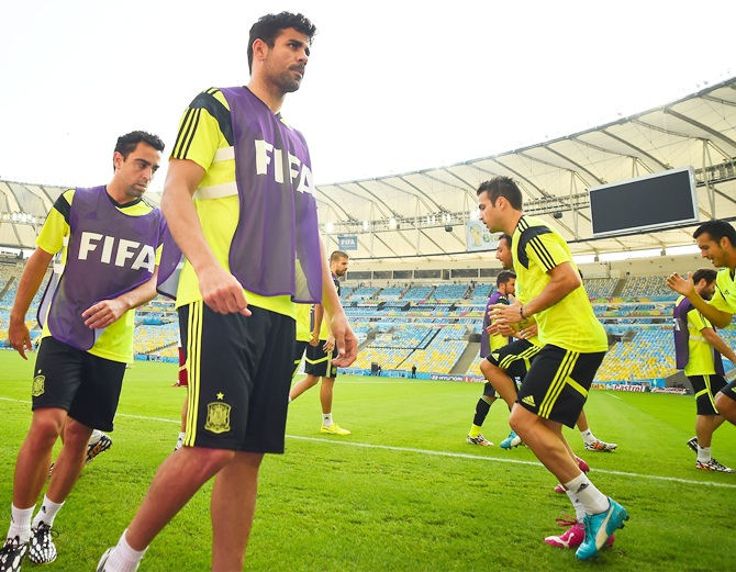 Spain players warm up during a training session