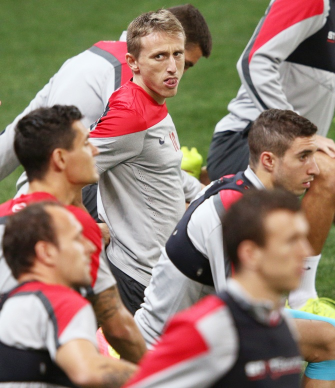 Luka Modric, centre, of Croatia looks on with his teammates during a Croatia training session