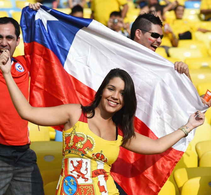 Chile and Spain fans cheer prior to the 2014 FIFA World Cup Brazil Group B match between Spain and Chile at Maracana