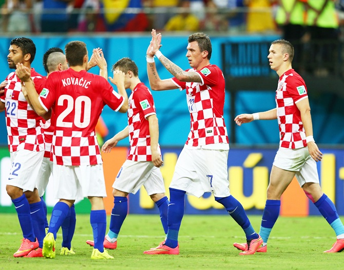 Mario Mandzukic of Croatia, second right, celebrates scoring his team's fourth goal, his second, during the 2014 FIFA World Cup against Cameroon