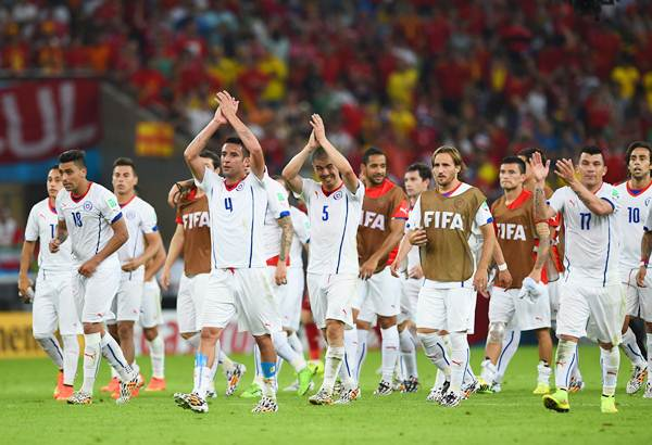 Mauricio Isla of Chile and his teammates ackonowledge applause from the fans after beating defending champions Spain a 2-0 in the Group B World Cup match.