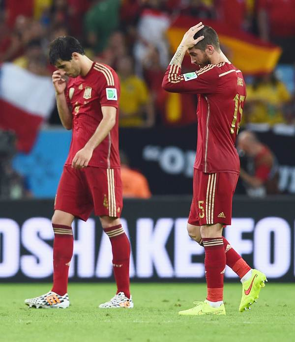 Spain's Javi Martinez and Sergio Ramos walk off the field after the defeat to Chile