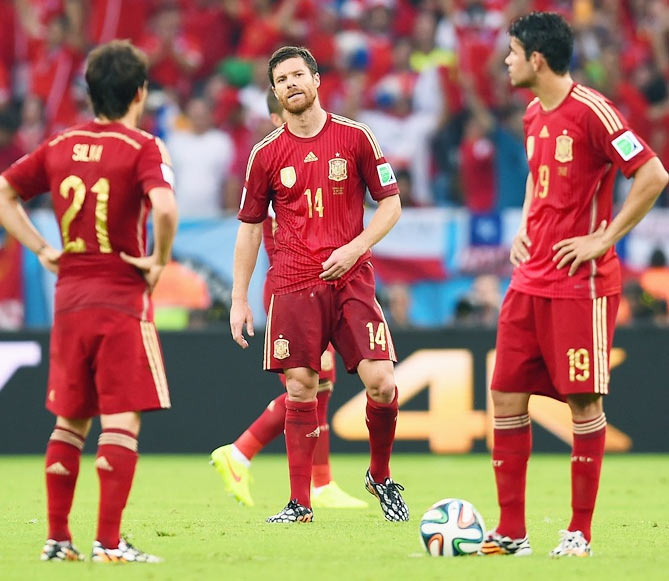 Xabi Alonso of Spain looks on with teammates