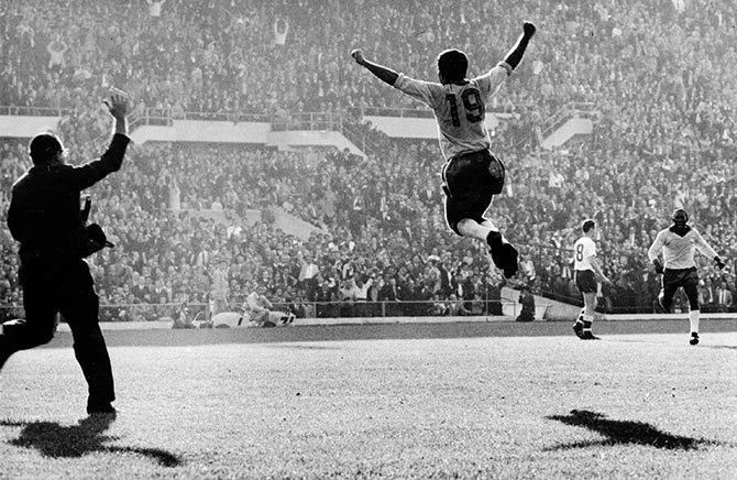 Brazilian player Zito (right) celebrates scoring the second goal for Brazil during the 1962 World Cup final against Czechoslovakia in Santiago, Chile